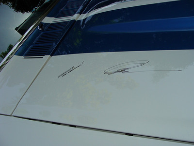 Pete Brock's signature.  Next to the iconic stripe pattern and hood scoop he designed.