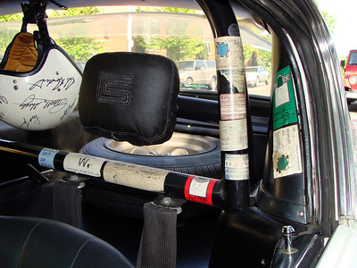 The roll bar wears many notable event stickers.  This car has some interesting tales to tell.